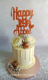 Rose Gold Roses Cake.png