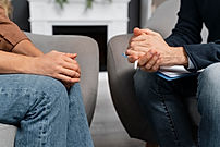 woman-and-counselor-holding-hands-togeth