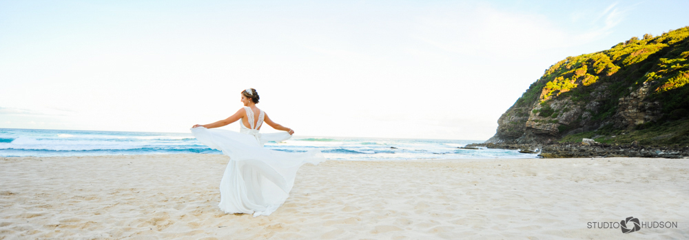 Bride Twirling on Beach