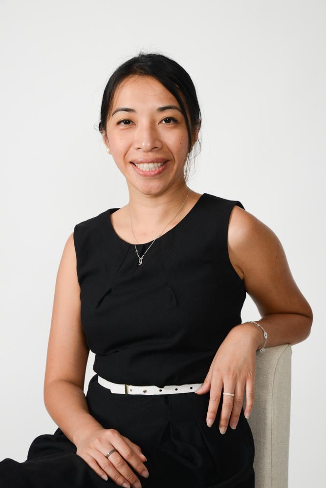 Woman in black dress Headshot