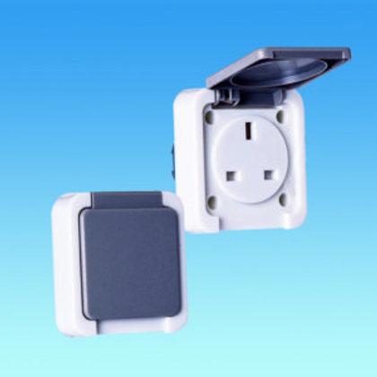 Slimline 230 volt socket with hinged flap