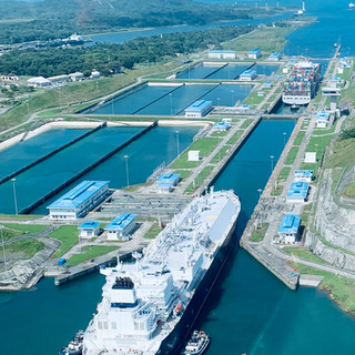 Neo Panamax LNG Ship and Container carrier going through Agua Clara Locks
