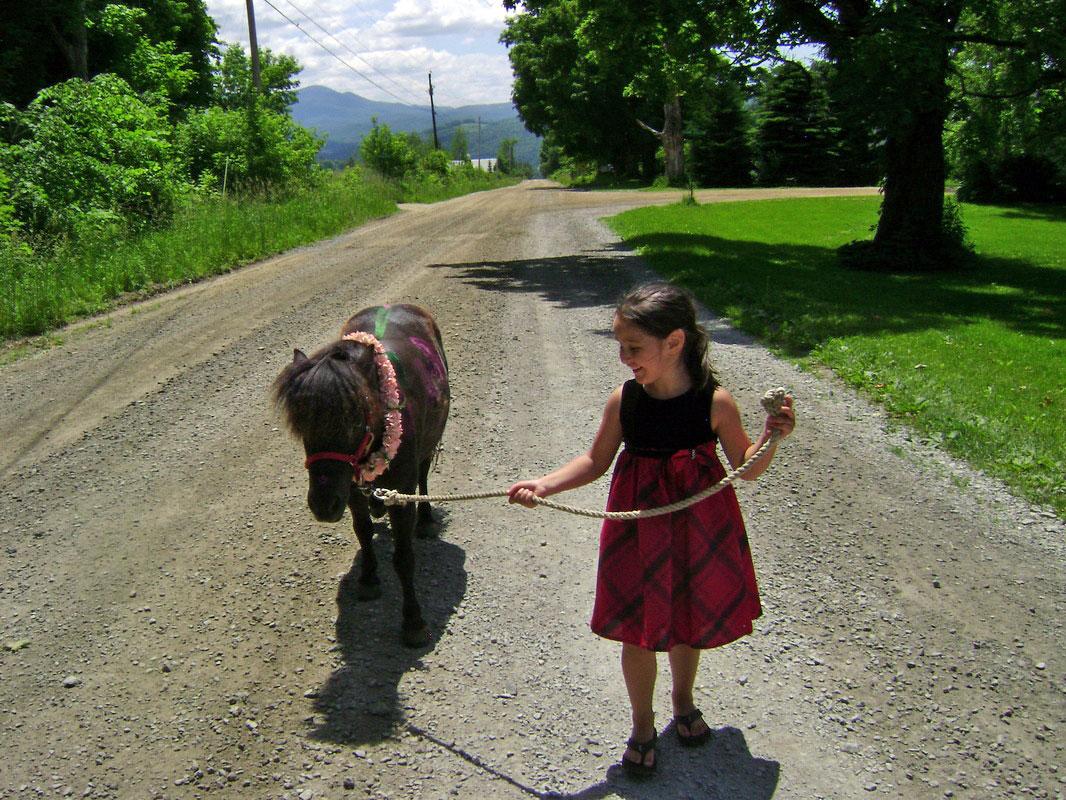 girl-leading-pony