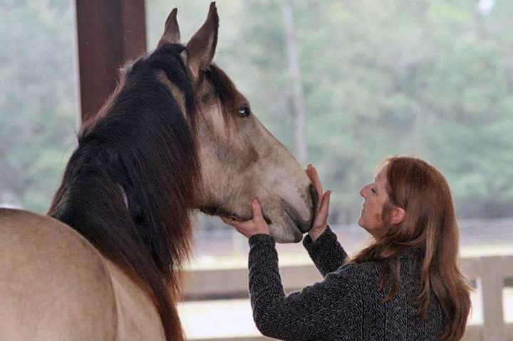 woman-stroking-horse