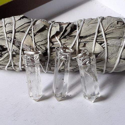 Pendentif Cristal de Roche serti métal argenté (pointe de Cristal)