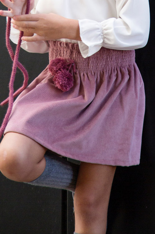 Falda rosa pom pom