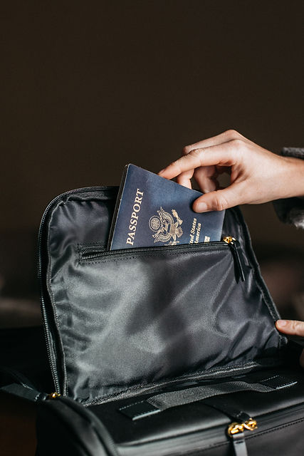 person-putting-a-passport-on-bag-842961.