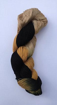 shade C - fine sashiko thread 370m skein black/beige/mustard varigated