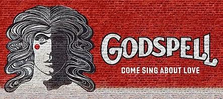 godspell-logo-on-brick-wall.jpg.webp