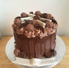 Reeses peanut butter cups, Hershey's and Ferrero Rocher Drip cake