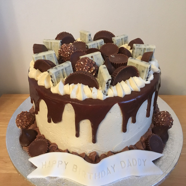 Ferrero Rocher, peanut butter cup and Hershey's drip cake