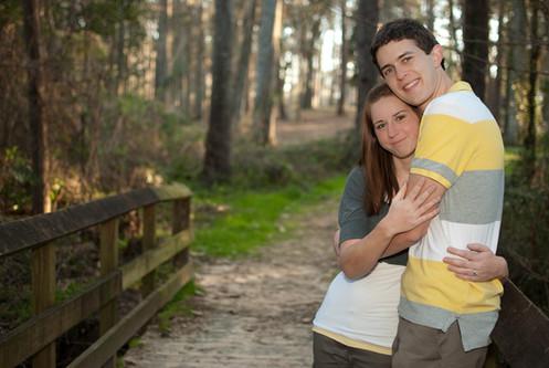 Engaged couple embrace