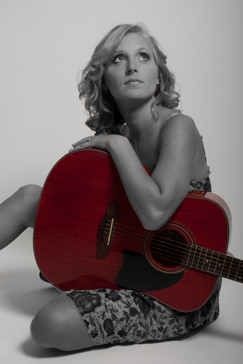 Model with guitar