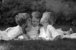 Kissing their baby sis
