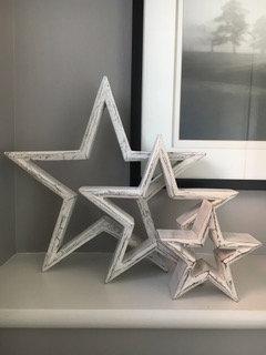 Set of three white mango wood mantle piece stars from Homebee