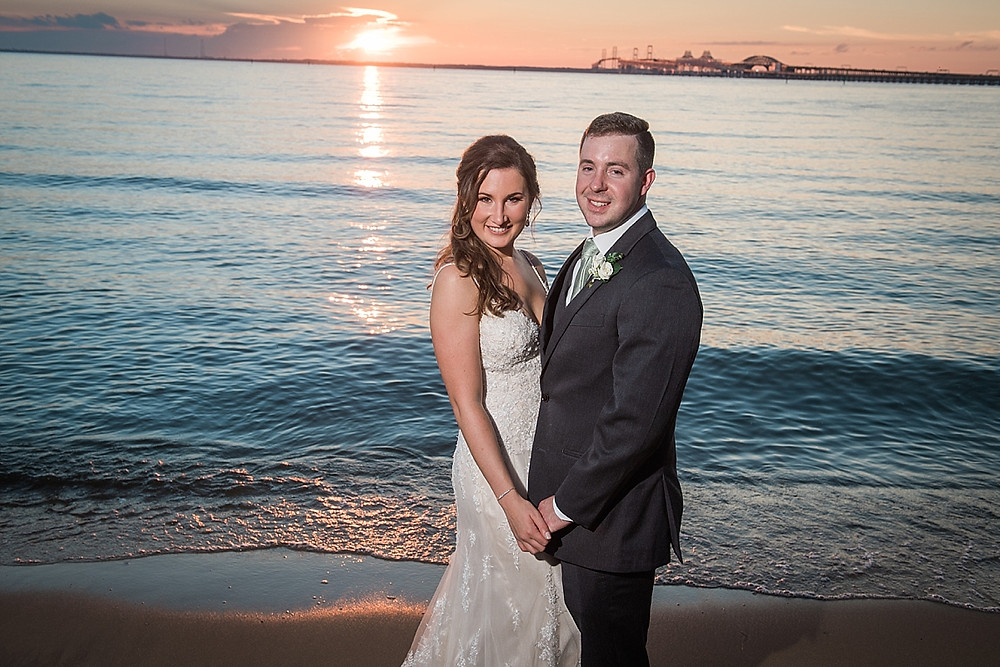 chesapeake bay beach club wedding couple on beach at sunset