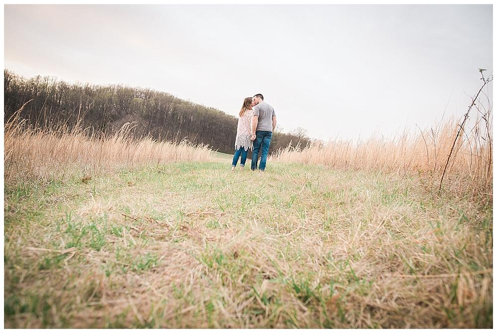 couple walking in long grass