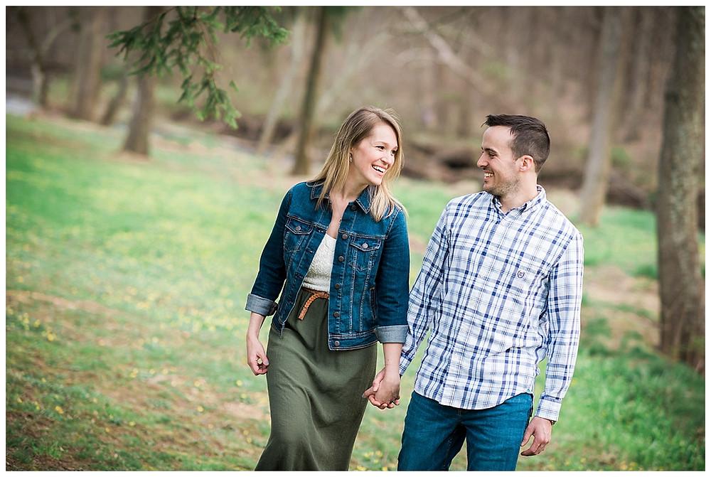 couple walking laughing at Jerusalem Mill Village