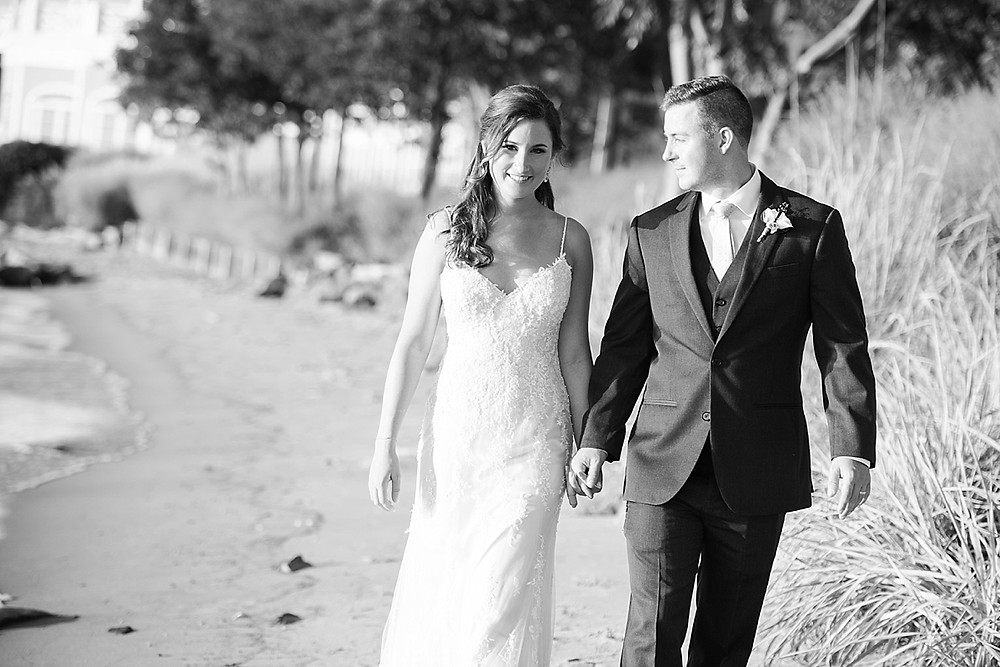 chesapeake bay beach club wedding couple walking on sand