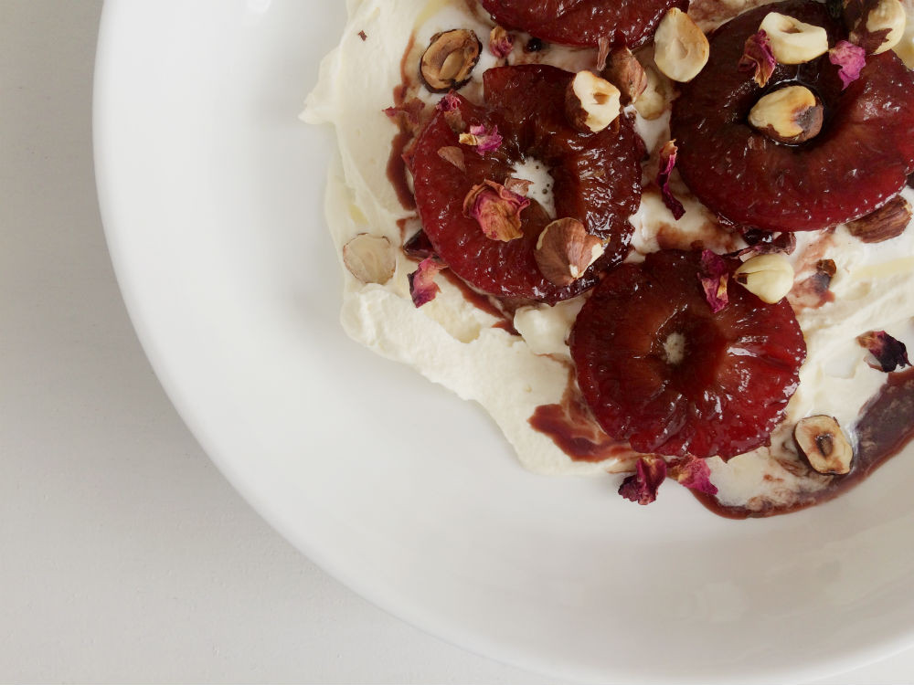 Spiced Poached Plums with cream and hazelnuts