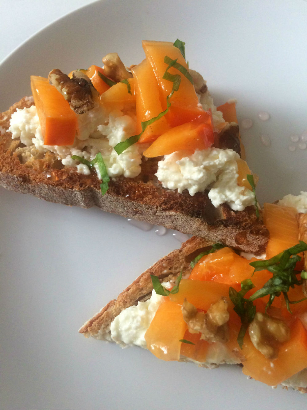 Persimmon, feta, basil and walnut toast