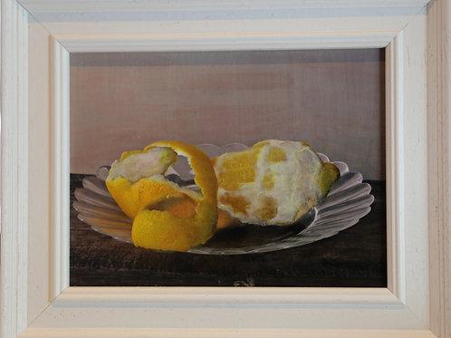 Lemon on a glass plate