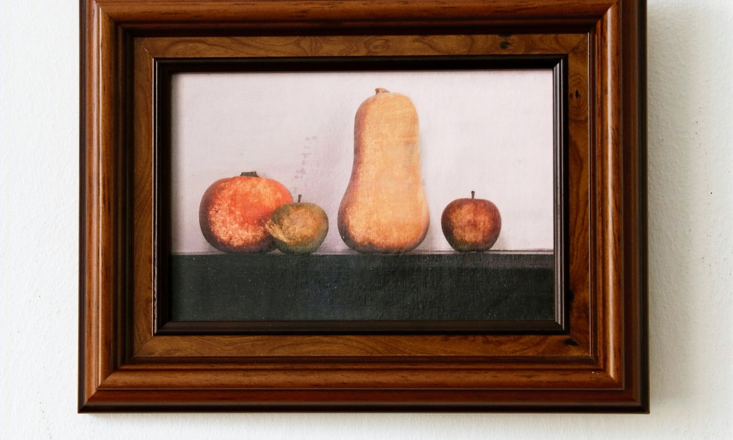 A Pumpkin, 2 Apples and a Squash in wooden frame