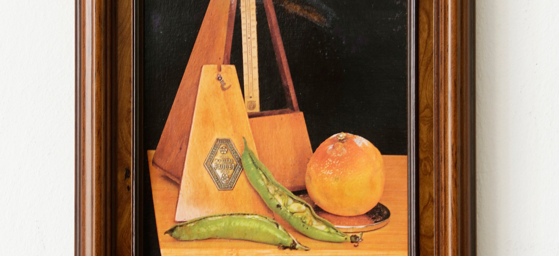 An Orange and some Beans in wooden frame