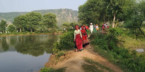 women walking along water body.jpg