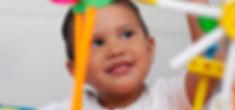 A cute boy playing with preschool math m