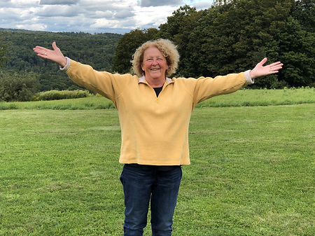 Sharon on Sound of Music Hill - arms out