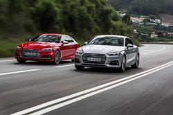 Audi cars on road