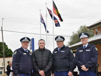 Police fly Aboriginal flag