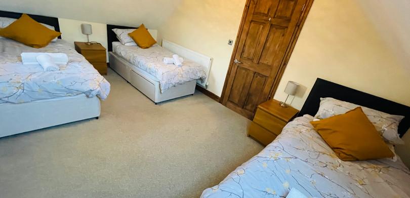 Heritage Cottage triple bedroom.jpeg