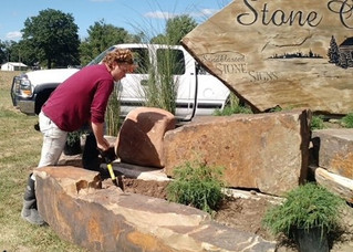 """MSC offers optional stands for our stone signs, installation, supplemental stone collage settings, and custom plantings. Unique and creative is our calling card. """"Your Story in Stone!"""""""