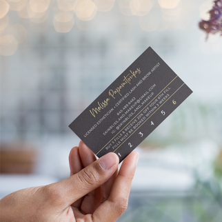 mockup-of-a-vertical-business-card-held-