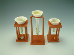 Set of various funnels with stands