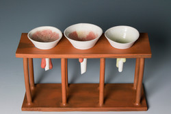 Set of three funnels with stand