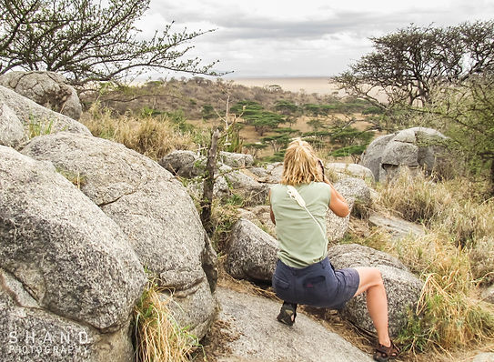 Photographer, woman, female, outdoor, safari, Africa, camera, rocks, distance,