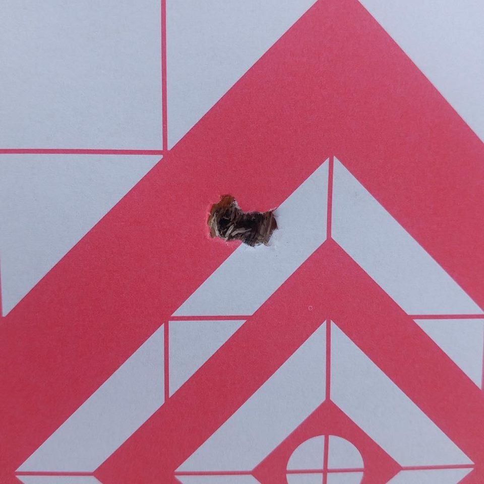 first 3-shot hole (group) out of a Rough Rider Tactical custom rifle package chambered in 22-250 Ack
