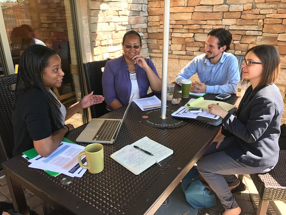 As part of CHACE's effort to engage candidates, Sim Wimbush, Molly Jacobson, and Zack Miller from the Virginia Housing Alliance meet with Delegate Jennifer Carroll Foy (D), who won her seat in November 2017.