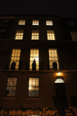 The front of the house at night