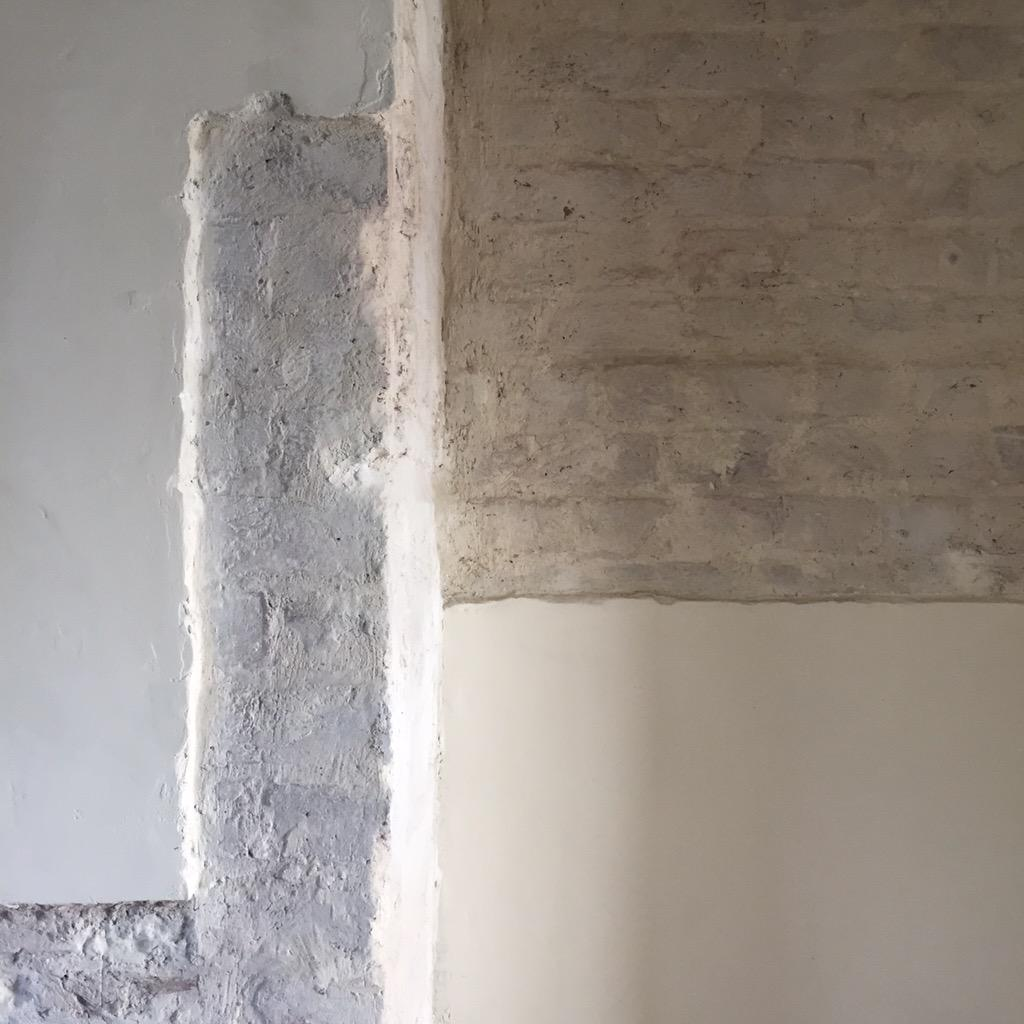 Room 2 exposed chimney breast