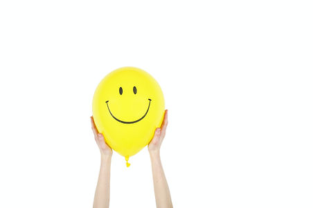 Smiley Face Balloon Being Held.jpg