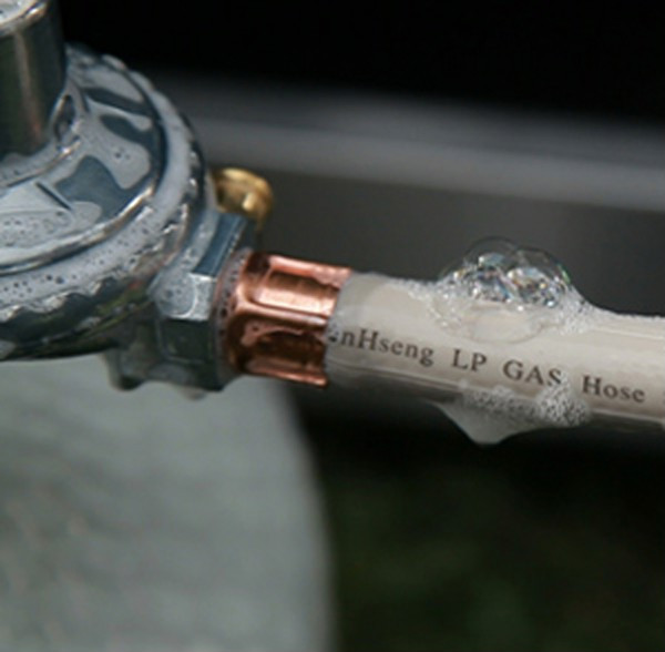 Bubbling solution applied to hose assembly