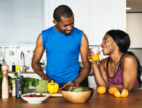 Black couple cooking healthy food in the