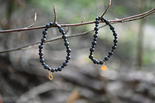 Lava & Onyx. Armketteli. Entschlossenheit. Tatkraft. Selbstbewusstsein.