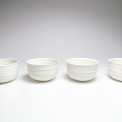 Simple porcelain bowls - I love how this white matte glaze highlights and softens the throwing rings