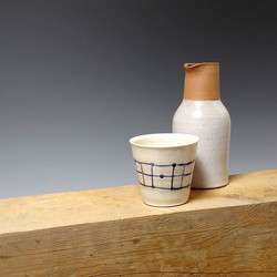 Porcelain cup with stoneware bottle