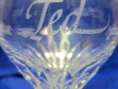 GLASS ENGRAVING: A $15. WINE GLASS GIFT IN 1993 IS STILL PRODUCING BUSINESS!